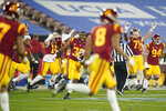 Southern California players run onto the field after winning an NCAA college football game against UCLA Saturday, Dec 12, 2020, in Pasadena, Calif. Southern (AP Photo/Ashley Landis)