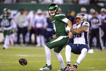 New York Jets quarterback Sam Darnold, left, loses control of the ball as he is sacked by New England Patriots' John Simon (55) during the first half of an NFL football game Monday, Oct. 21, 2019, in East Rutherford, N.J. (AP Photo/Bill Kostroun)