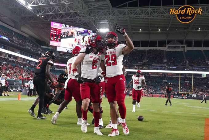 North Carolina State wide receiver Thayer Thomas (5) celebrates his touchdown with wide receiver Christopher Toudle (29) during the first half of the team''s NCAA college football game against Miami, Saturday, Oct. 23, 2021, in Miami Gardens, Fla. (AP Photo/Wilfredo Lee)