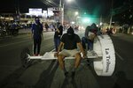 Demonstrators block a street during a protest demanding the resignation of President Juan Orlando Hernandez, in Tegucigalpa, Honduras, late Friday, Oct. 18, 2019. The protests come after Tony Hernandez, the brother of President Juan Orlando Hernandez, was convicted in a massive drug conspiracy, that prosecutors of the New York federal court say was protected by the Central American country's government. (AP Photo/Elmer Martinez)