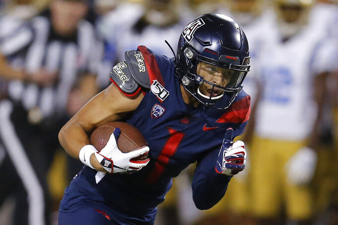 CORRECTS MONTH TO SEPTEMBER INSTEAD OF OCTOBER - Arizona wide receiver Drew Dixon makes the catch for a first down against UCLA in the first half during an NCAA college football game, Saturday, Sept. 28, 2019, in Tucson, Ariz. (AP Photo/Rick Scuteri)
