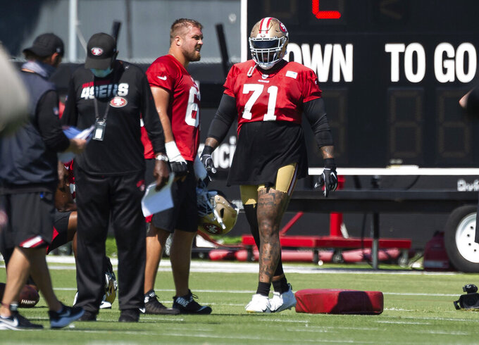 Newly acquired San Francisco 49ers offensive tackle Trent Williams (71), right, trains during NFL Training Camp practice Saturday, Aug. 15, 2020, at the SAP Performance Facility in Santa Clara, Calif. (Xavier Mascarenas/The Sacramento Bee via AP)