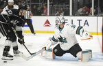 Los Angeles Kings left wing Austin Wagner, left, tries to get a shot past San Jose Sharks goaltender Martin Jones during the second period of an NHL hockey game Thursday, March 21, 2019, in Los Angeles. (AP Photo/Mark J. Terrill)
