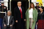 President Donald Trump and first lady Melania Trump welcome Ecuadorian President Lenin Moreno and his wife Rocio Gonzalez to the White House, Wednesday, Feb. 12, 2020, in Washington. (AP Photo/Evan Vucci)