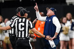 Georgia Tech head coach Geoff Collins points to the video board as he argues with officials during the second half of an NCAA college football game against North Carolina Saturday, Sept. 25, 2021, in Atlanta. (AP Photo/John Bazemore)