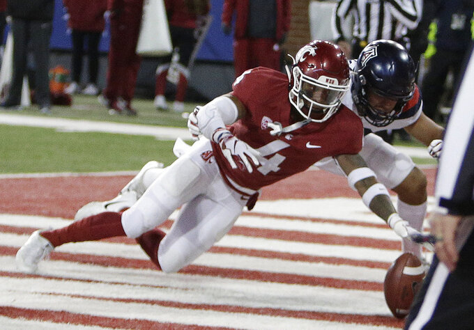 Washington State cornerback Marcus Strong (4) and Arizona wide receiver Shawn Poindexter go after an Arizona fumble, which Strong recovered during the first half of an NCAA college football game in Pullman, Wash., Saturday, Nov. 17, 2018. (AP Photo/Young Kwak)