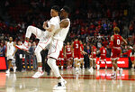 Maryland guard Anthony Cowan Jr., left, and forward Bruno Fernando, of Angola, celebrate after winning an NCAA college basketball game against Indiana, Friday, Jan. 11, 2019, in College Park, Md. (AP Photo/Patrick Semansky)