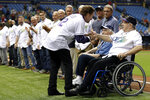 FILE - In this March 31, 2018, file photo, former Tampa Bay Devil Rays owner Vince Naimoli, right, shakes hands with former third baseman Wade Boggs during a ceremony honoring the inaugural 1998 team before a baseball game between the Rays and the Boston Red Sox in St. Petersburg, Fla. Original Tampa Bay Rays owner Vince Naimoli has died at 81. The team said Monday, Aug. 26, 2019, he died Sunday nearly five years after being diagnosed with an uncommon brain disorder.(AP Photo/Chris O'Meara, File)