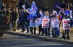 Nurses and supporters line the street outside of Saint Vincent Hospital Sunday, March 7, 2021, in Worcester, Mass., ahead of a rally on the eve of a possible strike. (Christine Peterson/Worcester Telegram & Gazette via AP)