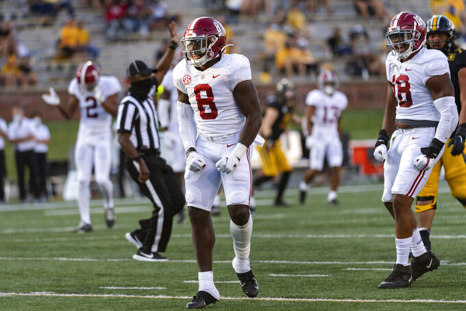 Alabama linebacker Christian Harris celebrates a sack of Missouri quarterback Shawn Robinson during the first quarter of an NCAA college football game Saturday, Sept. 26, 2020, in Columbia, Mo. (AP Photo/L.G. Patterson)