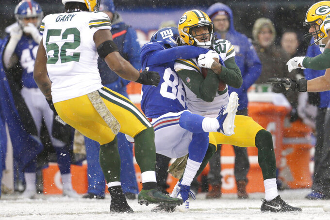 Green Bay Packers' Kevin King, right, is tackled after intercepting the ball during the first half of an NFL football game against the New York Giants, Sunday, Dec. 1, 2019, in East Rutherford, N.J. (AP Photo/Adam Hunger)