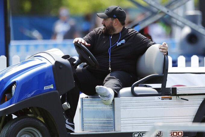 Detroit Lions coach Matt Patricia drives a cart during training camp at the Lions NFL football practice facility, Thursday, July 25, 2019, in Allen Park, Mich. Patricia is beginning his second training camp with a cast on his left leg after being treated for a tendon problem in his lower leg. (AP Photo/Carlos Osorio)