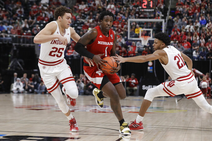 Nebraska's Kevin Cross (1) goes to the basket against Indiana's Race Thompson (25) and Jerome Hunter (21) during the second half of an NCAA college basketball game at the Big Ten Conference tournament, Wednesday, March 11, 2020, in Indianapolis. Indiana won 89-64. (AP Photo/Darron Cummings)