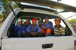 In this photo taken on Thursday, Nov. 14, 2019, Workers are packed into the back of a farmers pickup truck in Vosburg, South Africa, where they have been offered a day's work to earn some money. The worst drought some farmers have seen in decades is affecting much of southern Africa. The United Nations says more than 11 million people now face crisis levels of food insecurity. (AP Photo/Denis Farrell)