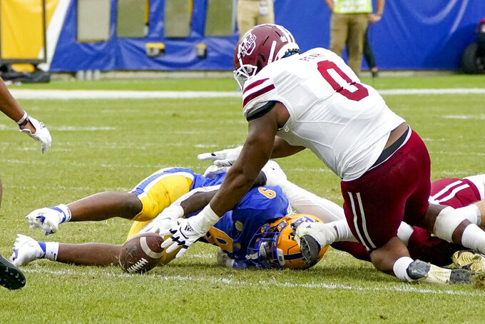 Massachusetts defensive lineman Avien Peah (0) recovers a fumble by Pittsburgh running back Rodney Hammond Jr. (9) during the second half of an NCAA college football game, Saturday, Sept. 4, 2021, in Pittsburgh. Pittsburgh won 51-7.(AP Photo/Keith Srakocic)
