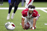 Arizona Cardinals quarterback Kyler Murray (1) gets up off the turf after losing his helmet while being sacked by New Orleans Saints defensive end Cameron Jordan, not pictured, in the second half of an NFL football game in New Orleans, Sunday, Oct. 27, 2019. (AP Photo/Bill Feig)