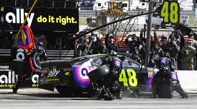Driver Jimmie Johnson's pit crew service his car during a NASCAR Cup auto race at Texas Motor Speedway, Sunday, March 31, 2019, in Fort Worth, Texas. (AP Photo/Larry Papke)
