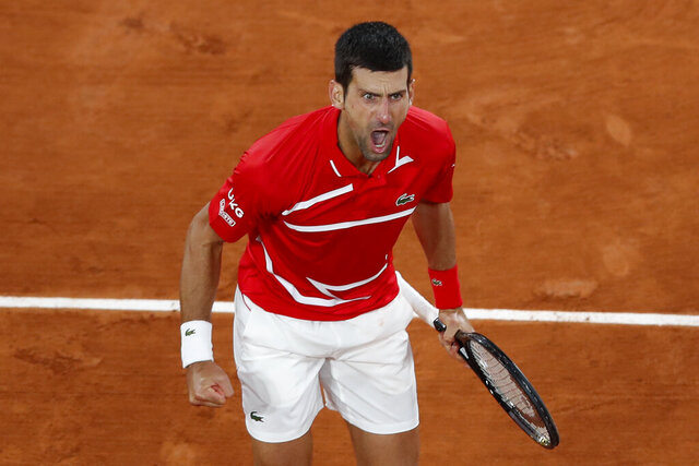 Serbia's Novak Djokovic screams after scoring a point against Greece's Stefanos Tsitsipas in the semifinal match of the French Open tennis tournament at the Roland Garros stadium in Paris, France, Friday, Oct. 9, 2020. (AP Photo/Alessandra Tarantino)