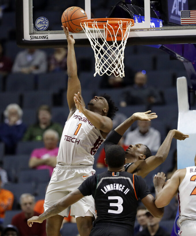 Virginia Tech's Isaiah Wilkins (1) shoots past Miami's Anthony Lawrence II (3) during the second half of an NCAA college basketball game in the Atlantic Coast Conference tournament in Charlotte, N.C., Wednesday, March 13, 2019. (AP Photo/Chuck Burton)