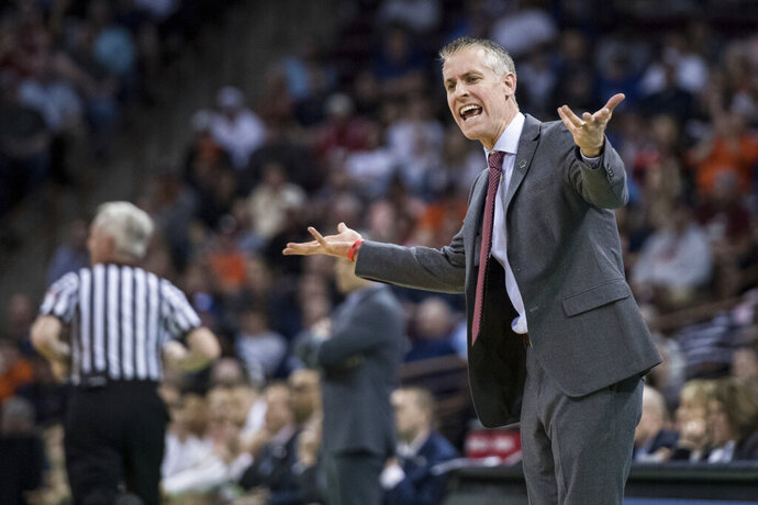 Gardner-Webb head coach Tim Craft communicates with an official during a first-round game against Virginia in the NCAA men's college basketball tournament Friday, March 22, 2019, in Columbia, S.C. Virginia defeated Gardner-Webb 71-56. (AP Photo/Sean Rayford)