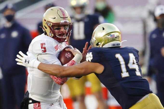 FILE - Notre Dame safety Kyle Hamilton (14) reaches for Boston College quarterback Phil Jurkovec (5) during the first half of an NCAA college football game in Boston, in this Saturday, Nov. 14, 2020, file photo. Hamilton was selected to The Associated Press Preseason All-America first team defense, Monday Aug. 23, 2021. (AP Photo/Michael Dwyer, File)