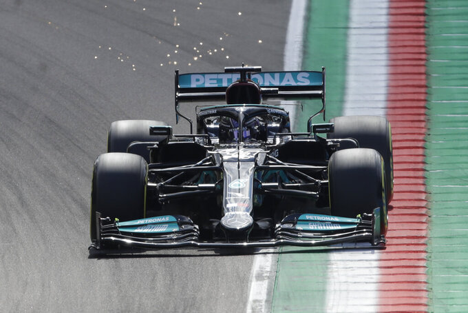 Mercedes driver Lewis Hamilton of Britain steers his car during the second free practice session for Sunday's Emilia Romagna Formula One Grand Prix, at the Imola track, Italy, Friday, April 16, 2021. (AP Photo/Luca Bruno)