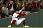 Boston Red Sox's Enrique Hernandez points to Hunter Renfroe, who had thrown out Tampa Bay Rays' Joey Wendle at third base for the final out in Boston's 2-1 win in a baseball game Wednesday, Sept. 8, 2021, at Fenway Park in Boston. (AP Photo/Winslow Townson)
