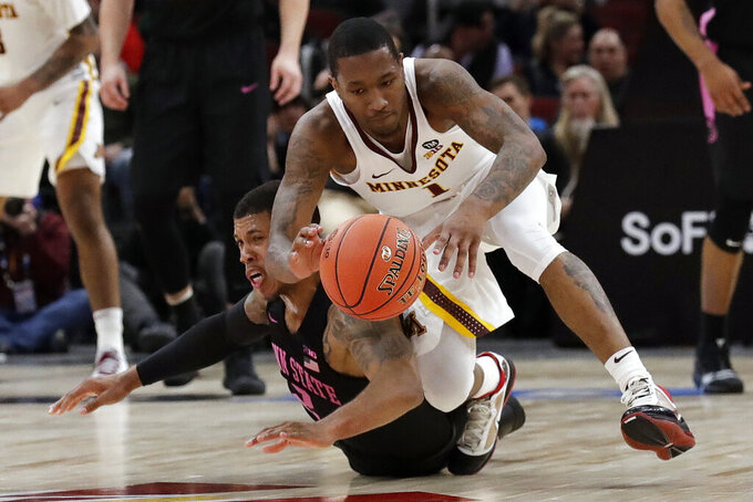 Minnesota guard Dupree McBrayer (1) and Penn State's Myles Dread (2) battle for a loose ball during the first half of an NCAA college basketball game in the second round of the Big Ten Conference tournament, Thursday, March 14, 2019, in Chicago. (AP Photo/Nam Y. Huh)