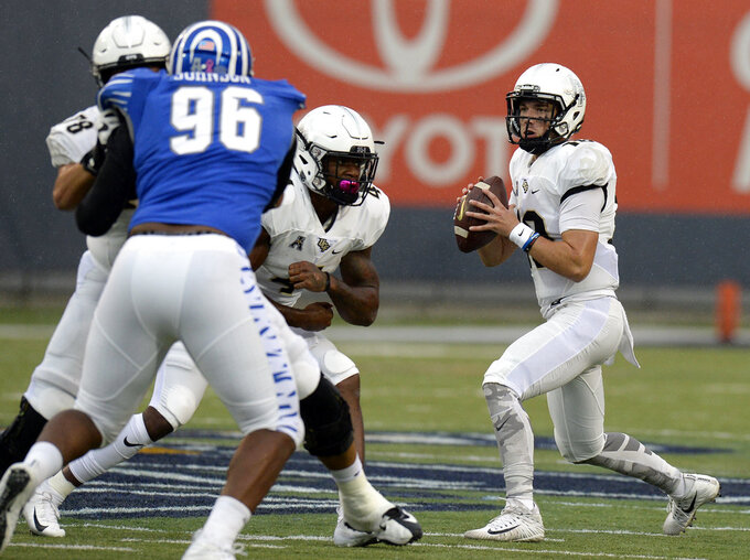 Central Florida quarterback McKenzie Milton, right, passes against Memphis during the second half of an NCAA college football game Saturday, Oct. 13, 2018, in Memphis, Tenn. Central Florida won 31-30. (AP Photo/Mark Zaleski)