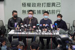 FILE - In this Jan. 8, 2021, file photo, former Democratic Party legislators Andrew Wan, left, Lam Cheuk-ting, second left, and Helena Wong, right, attend a news conference after being released on bail in Hong Kong. Although pro-democracy and human rights activists around the globe were stunned to see a raging mob storm the U.S. Capitol, they say they were heartened and inspired because the system ultimately prevailed. Hong Kong police tightened their grip on the city's embattled democracy movement, making 53 arrests Wednesday, hours before the events in Washington. (AP Photo/Kin Cheung, File)