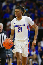 Boise State guard Derrick Alston (21) brings during the second half of the team's NCAA college basketball game against San Diego State, Sunday, Feb. 16, 2020, in Boise, Idaho. San Diego State won 72-55. (AP Photo/Steve Conner)