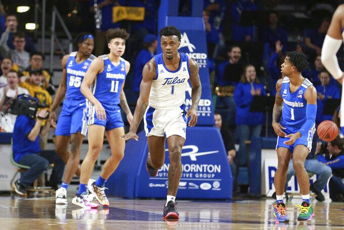 Tulsa  forward Martins Igbanu (1) celebrates after scoring in the first half of an NCAA college basketball game against Memphis in Tulsa, Okla., Wednesday, Jan. 22, 2020. (AP Photo/Joey Johnson)