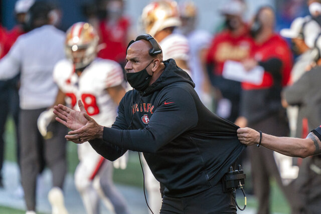 FILE - In this Nov. 1, 2020, file photo, then-San Francisco 49ers defensive coordinator Robert Saleh cheers on his team from the sideline during the first half of an NFL football game against the Seattle Seahawks, in Seattle. The New York Jets' new head coach is charged with turning around the fortunes of a franchise that has missed out on the playoffs the past 10 seasons — the NFL's longest active drought — and has a few generations of frustrated fans impatiently waiting for at least a chance at another Super Bowl. After all, it has been 52 years and counting.  (AP Photo/Stephen Brashear, File)