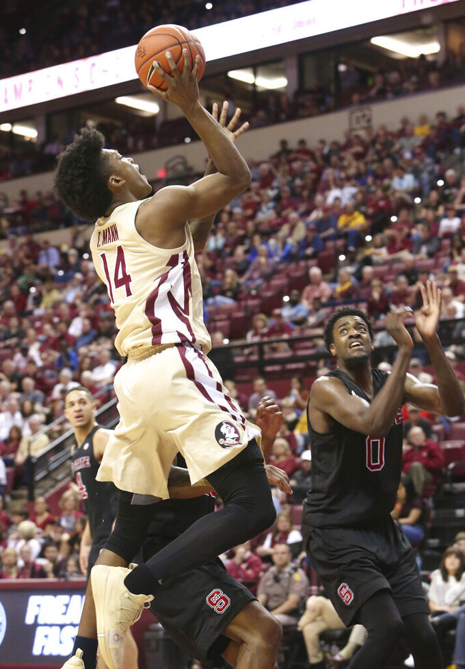 Florida State's Terance Mann attempts a shot past North Carolina State's DJ Funderburk, right, in the first half of an NCAA college basketball game Saturday, March 2, 2019, in Tallahassee, Fla. (AP Photo/Steve Cannon)