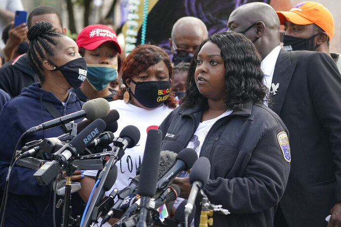 Bianca Austin speaks during a news conference, Friday, Sept. 25, 2020, in Louisville, Ky. Breonna Taylor's family attorney Ben Crump is calling for the Kentucky attorney general to release the transcripts from the grand jury that decided not to charge any of the officers involved in the Black woman's death.  (AP Photo/Darron Cummings)