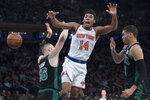New York Knicks guard Allonzo Trier (14) is fouled as the drives to the basket against Boston Celtics forward Aron Baynes (46) and Boston Celtics forward Jayson Tatum (0) during the first half of an NBA basketball game, Saturday, Oct. 20, 2018, at Madison Square Garden in New York. (AP Photo/Mary Altaffer)