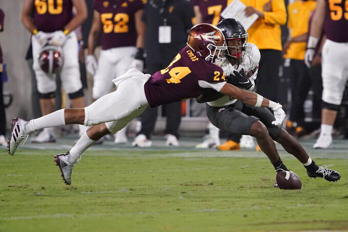 Arizona State defensive back Chase Lucas (24) knocks down a pass intended for UNLV wide receiver Kyle Williams during the second half of an NCAA college football game, Saturday, Sept. 11, 2021, in Tempe, Ariz. (AP Photo/Matt York)