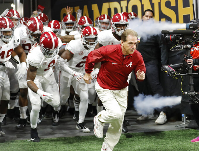 FILE - In this Jan. 8, 2018, file photo, Alabama head coach Nick Saban leads his team on the field before the NCAA college football playoff championship game against Georgia in Atlanta. Neither No. 1 Alabama nor No. 4 Georgia is anxiously awaiting their playoff fates this season, but whoever wins the SEC championship game showdown is definitely in the playoffs. The Crimson Tide could even get in with a close loss.(AP Photo/David Goldman, File)