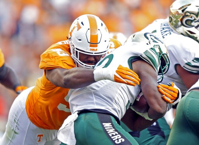 FILE - In this Nov. 3, 2018, file photo, Tennessee defensive lineman Emmit Gooden (93) tackles Charlotte running back Benny LeMay (32) during the first half of an NCAA college football game in Knoxville, Tenn. Gooden will miss the entire season with a knee injury, leaving the Volunteers without their most experienced player on a defensive line that has no returning starters. Vols coach Jeremy Pruitt says Gooden tore his anterior cruciate ligament Tuesday, Aug. 6, and will undergo surgery next week. (AP Photo/Wade Payne, File)