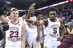 South Carolina's Jermaine Couisnard (5) and Mike Green (23) celebrate with teammates after an NCAA college basketball game against Kentucky on Wednesday, Jan. 15, 2020, in Columbia, S.C. South Carolina won 81-78. (AP Photo/Sean Rayford)