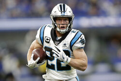 FILE - In this Dec. 22, 2019, file photo, Carolina Panthers' Christian McCaffrey runs during the second half of an NFL football game against the Indianapolis Colts, in Indianapolis. McCaffrey's versatility and superb statistics helped him to a rare double: The Carolina Panthers running back has made The Associated Press NFL All-Pro Team at two positions. (AP Photo/Michael Conroy, File)