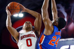 Georgia's Donnell Gresham Jr. (0) shoots while defended by Florida forward Kerry Blackshear Jr. (24) during the first half of an NCAA college basketball game Wednesday, March 4, 2020, in Athens, Ga. (Joshua L. Jones/Athens Banner-Herald via AP)