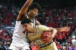 Georgia Tech guard Michael Devoe (0) tries to get through the defense of Louisville forward Dwayne Sutton (24) during the first half of an NCAA college basketball game in Louisville, Ky., Wednesday, Jan. 22, 2020. (AP Photo/Timothy D. Easley)