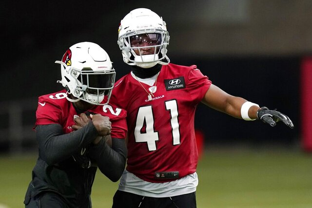 Arizona Cardinals running backs Chase Edmonds (29) and Kenyan Drake (41) run a drill during an NFL football workout Wednesday, Aug. 12, 2020, in Glendale, Ariz. (AP Photo/Ross D. Franklin)