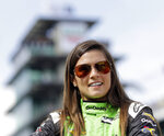 FILE - In this May 20, 2018, file photo, Danica Patrick waits during qualifications for the IndyCar Indianapolis 500 auto race at Indianapolis Motor Speedway in Indianapolis. Patrick, who retired from racing after last year's Indianapolis 500, will join NBC Sports' inaugural coverage of the Indianapolis 500 as a studio analyst alongside host Mike Tirico. (AP Photo/Darron Cummings, File)