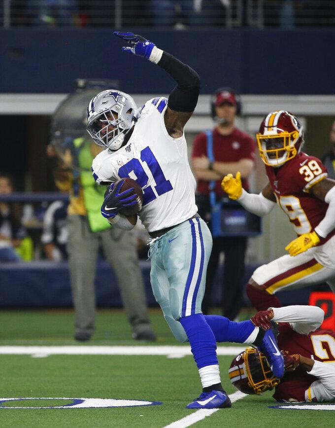 Dallas Cowboys running back Ezekiel Elliott (21) runs for a touchdown against the Washington Redskins during the first half of an NFL football game in Arlington, Texas, Sunday, Dec. 15, 2019. (AP Photo/Ron Jenkins)