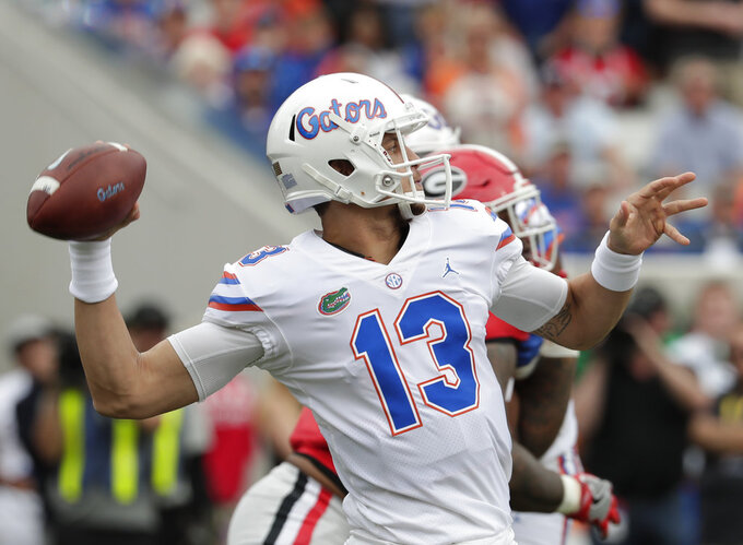 Florida quarterback Feleipe Franks looks to pass against Georgia during the first half of an NCAA college football game Saturday, Oct. 27, 2018, in Jacksonville, Fla. (AP Photo/John Raoux)