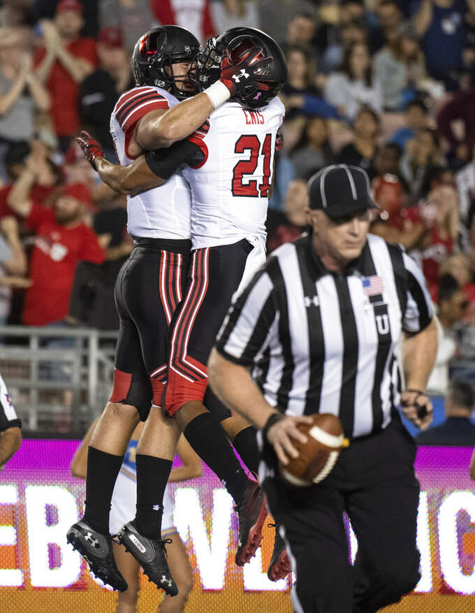 Utah tight end Cole Fotheringham, left, and wide receiver Solomon Enis celebrate Fotheringham's touchdown during the first half of an NCAA college football game against UCLA Friday, Oct. 26, 2018, in Pasadena, Calif. (AP Photo/Kyusung Gong)