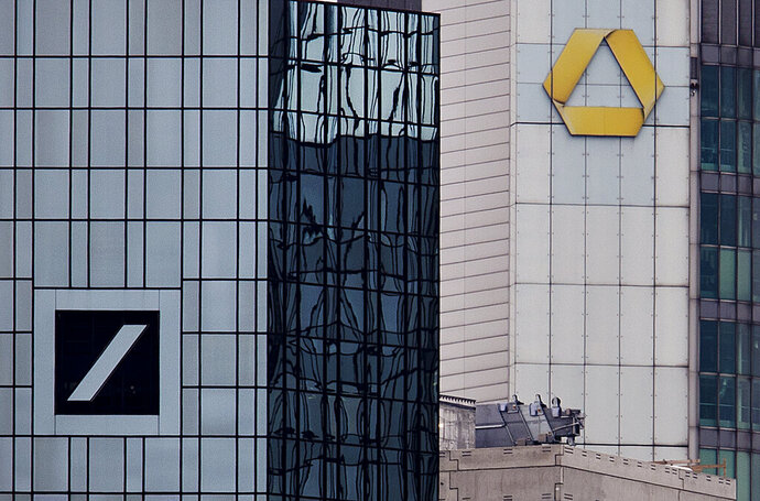 Headquarters of Deutsche Bank, left, and Commerzbank are seen in Frankfurt, Germany, Monday, March 18, 2019. Deutsche Bank and Commerzbank begin talks on a possible merger. (AP Photo/Michael Probst)