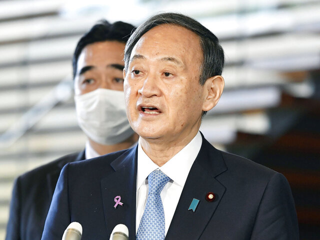 Japanese Prime Minister Yoshihide Suga speaks to the media after he held the telephone talk with U.S. President-elect Joe Biden, at the prime minister's official residence in Tokyo Thursday, Nov. 12, 2020. Suga said he held telephone talks with President-elect Biden on Thursday morning and reaffirmed the importance of their alliance and agreed to further deepen it for the peace and stability in the Indo-Pacific region amid China's growing influence and North Korea's nuclear threat.(Yoshitaka Sugawara/Kyodo News via AP)